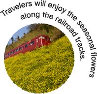 Travelers will enjoy the seasonal flowers along the railroad tracks.